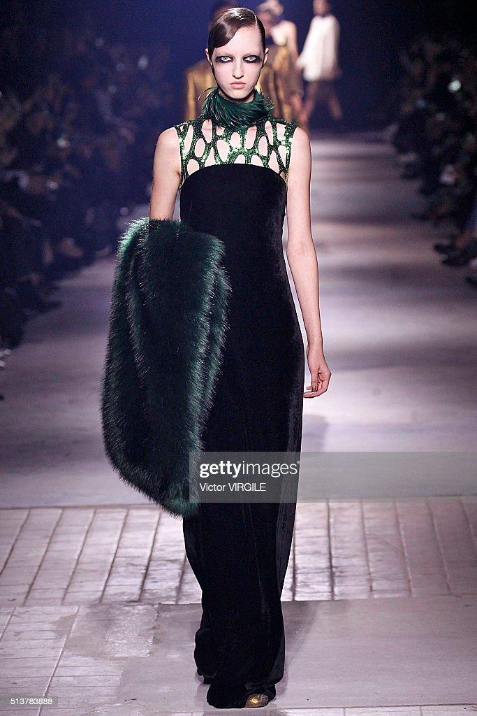Model walks the runway during the dries van noten fashion show as