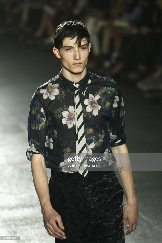 A model walks the runway during the Dries Van Noten Menswear Spring/Summer 2014 show as part of the Paris Fashion Week on June 27, 2013 in Paris, France.