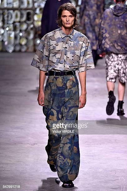 A model walks the runway during the Dries Van Noten Menswear Spring/Summer 2017 show as part of Paris Fashion Week on June 23 2016 in Paris France