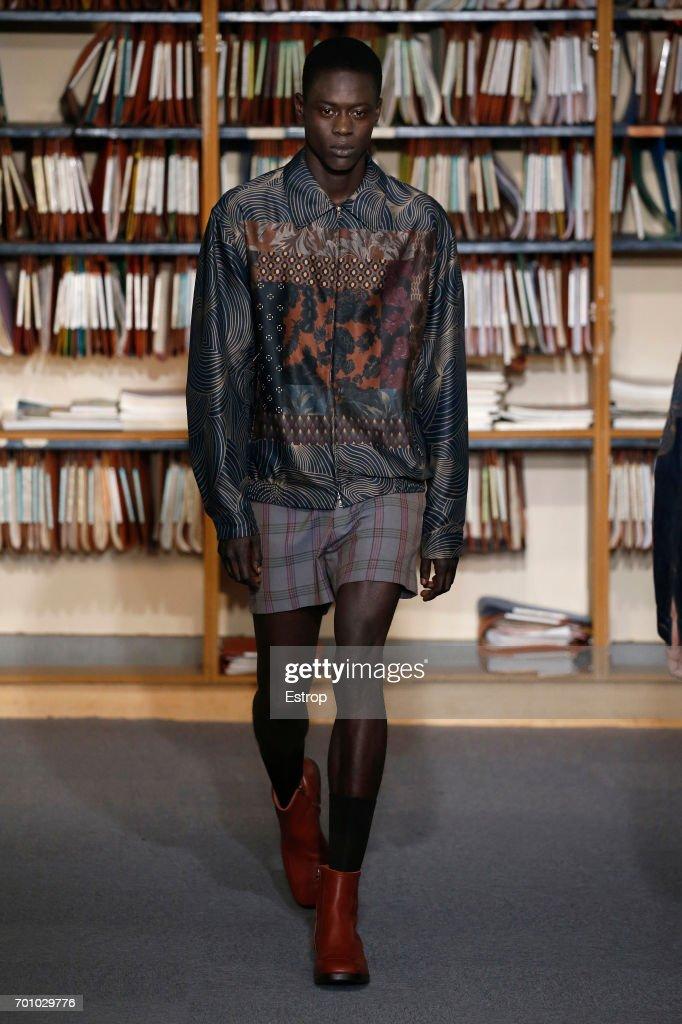 model-walks-the-runway-during-the-dries-van-noten-menswear-2018-show-picture-id701029776