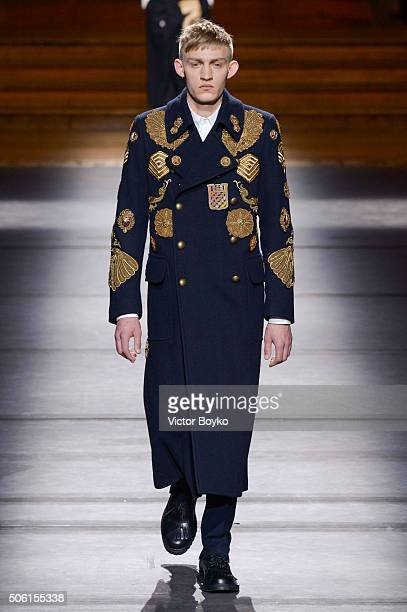 A model walks the runway during the Dries Van Noten Menswear Fall/Winter 20162017 show as part of Paris Fashion Week on January 21 2016 in Paris...