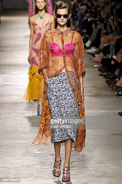A model walks the runway during the Dries Van Noten Ready to Wear show as part of the Paris Fashion Week Womenswear Spring/Summer 2016 on September...