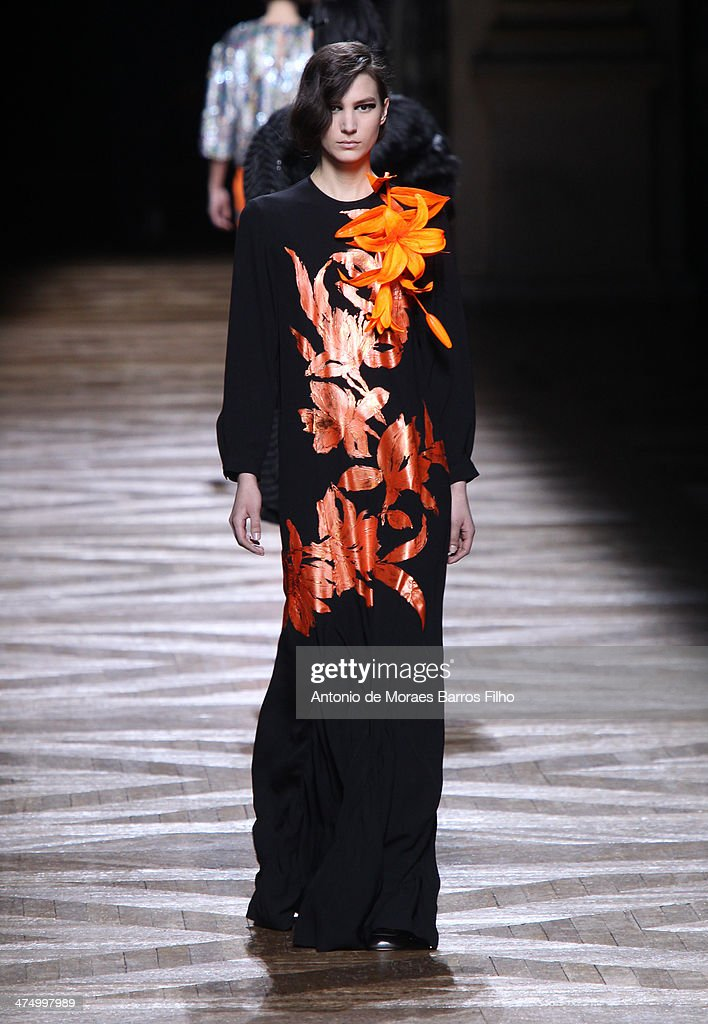 A model walks the runway during the Dries Van Noten show as part of the Paris Fashion Week Womenswear Fall/Winter 2014-2015 on February 26, 2014 in Paris, France.