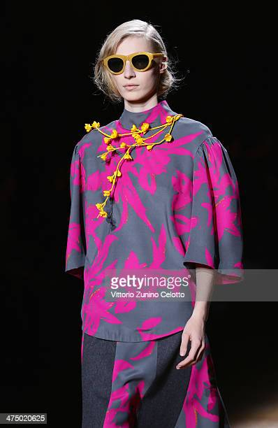 A model walks the runway during the Dries Van Noten show as part of the Paris Fashion Week Womenswear Fall/Winter 20142015 at Hotel de Ville on...