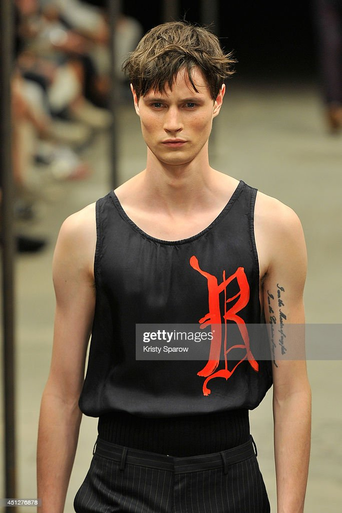 A model walks the runway during the Dries Van Notten show as part of Paris Fashion Week Menswear Spring/Summer 2015 on June 26, 2014 in Paris, France.