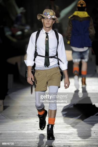 A model walks the runway during the Dsquared2 fashion show at Milan Fashion Week Menswear Spring/Summer 2010 on June 23 2009 in Milan Italy