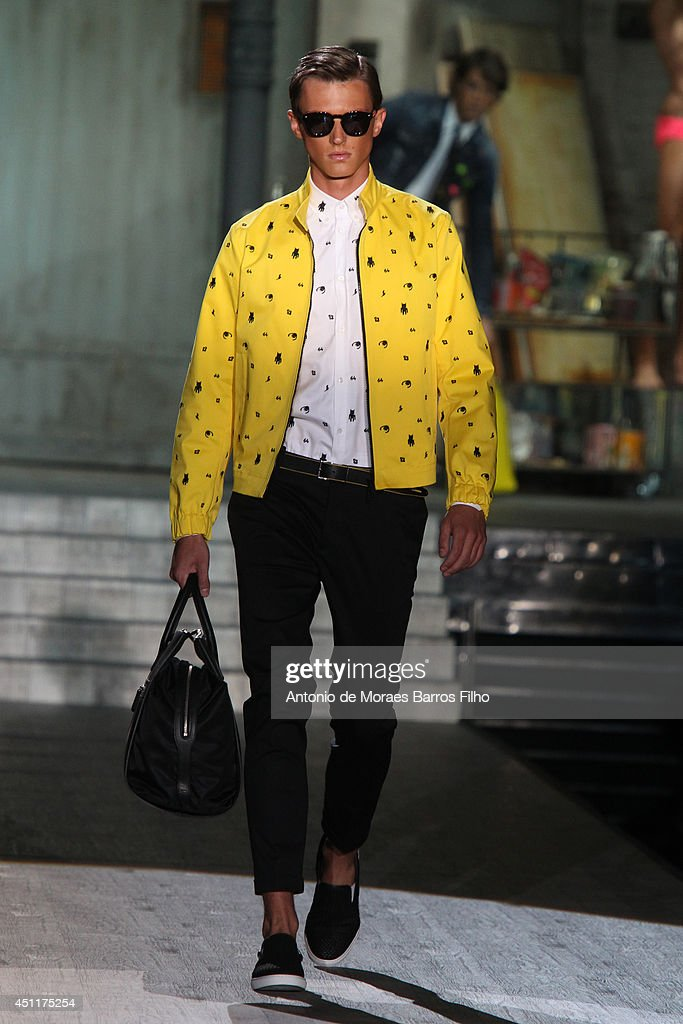 A model walks the runway during the DSquared2 show as a part of Milan Fashion Week Menswear Spring/Summer 2015 on June 24, 2014 in Milan, Italy.