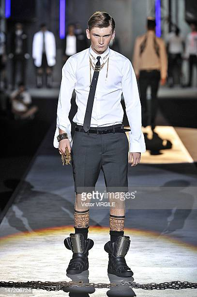 A model walks the runway during the DSquared2 show as part of Milan Fashion Week Menswear Spring/Summer 2013 on June 26 2012 in Milan Italy