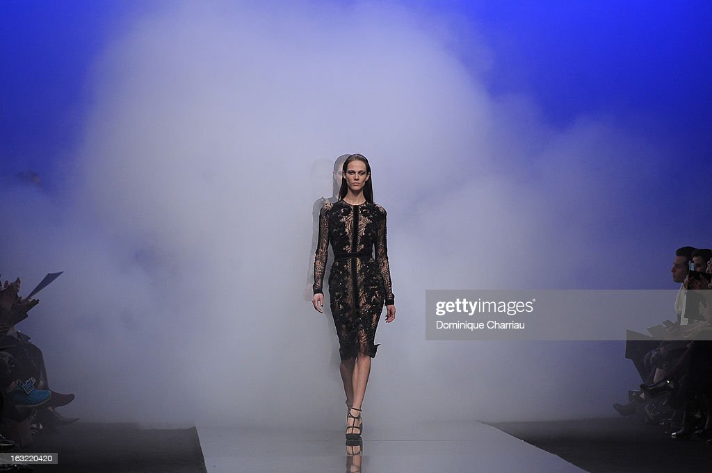A model walks the runway during the Elie Saab Fall/Winter 2013 Ready-to-Wear show as part of Paris Fashion Week on March 6, 2013 in Paris, France.