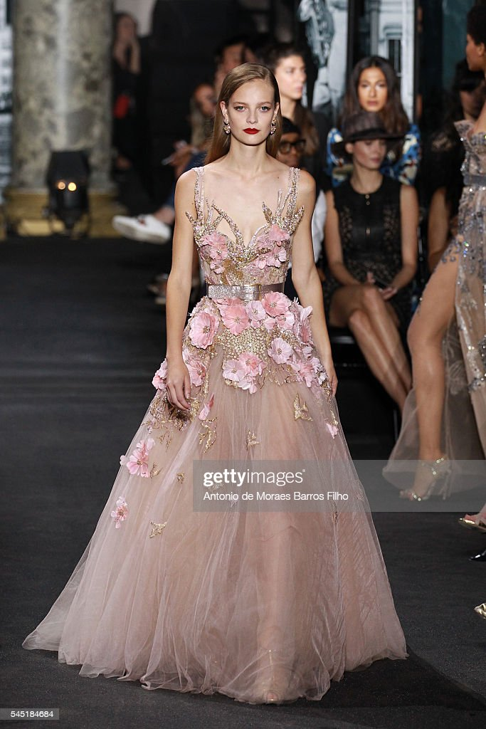 a model walks the runway during the elie saab haute couture fallwinter
