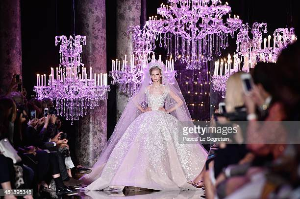 A model walks the runway during the Elie Saab show as part of Paris Fashion Week Haute Couture Fall/Winter 20142015 at Pavillon Cambon Capucines on...