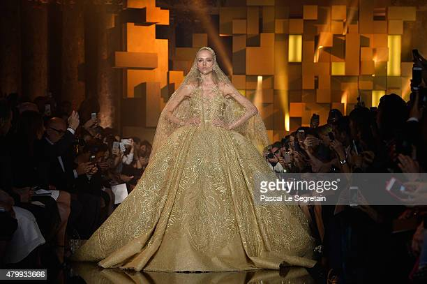 A model walks the runway during the Elie Saab show as part of Paris Fashion Week Haute Couture Fall/Winter 2015/2016 on July 8 2015 in Paris France