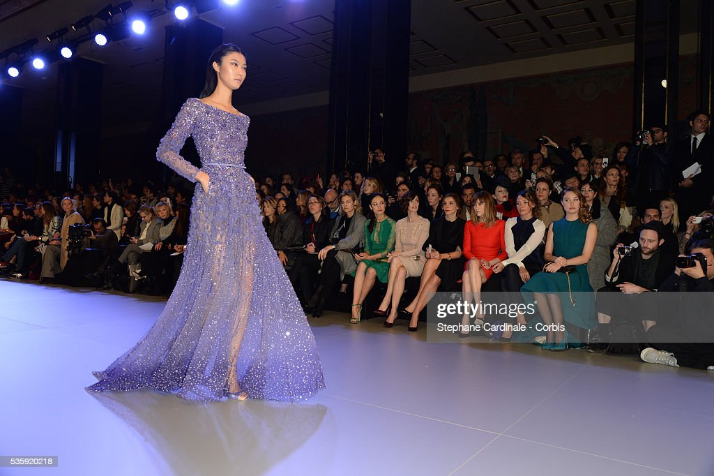 A model walks the runway during the Elie Saab show as part of Paris Fashion Week Haute Couture Spring/Summer 2014 , at Theatre National de Chaillot, in Paris.