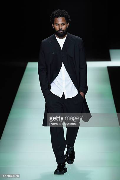 A model walks the runway during the Emporio Armani fashion show as part of Milan Men's Fashion Week Spring/Summer 2016 on June 20 2015 in Milan Italy