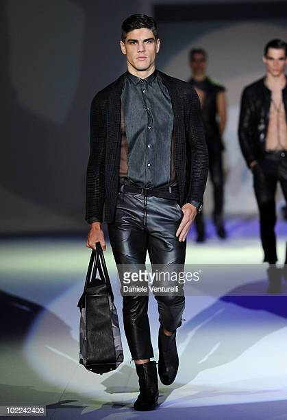 A model walks the runway during the Emporio Armani Milan Menswear Spring/Summer 2011 show on June 20 2010 in Milan Italy
