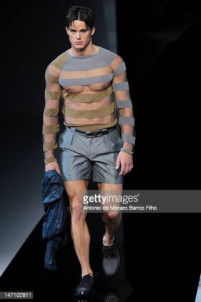 A model walks the runway during the Emporio Armani show as a part of Milan Fashion Week Menswear Spring/Summer 2013 on June 25 2012 in Milan Italy