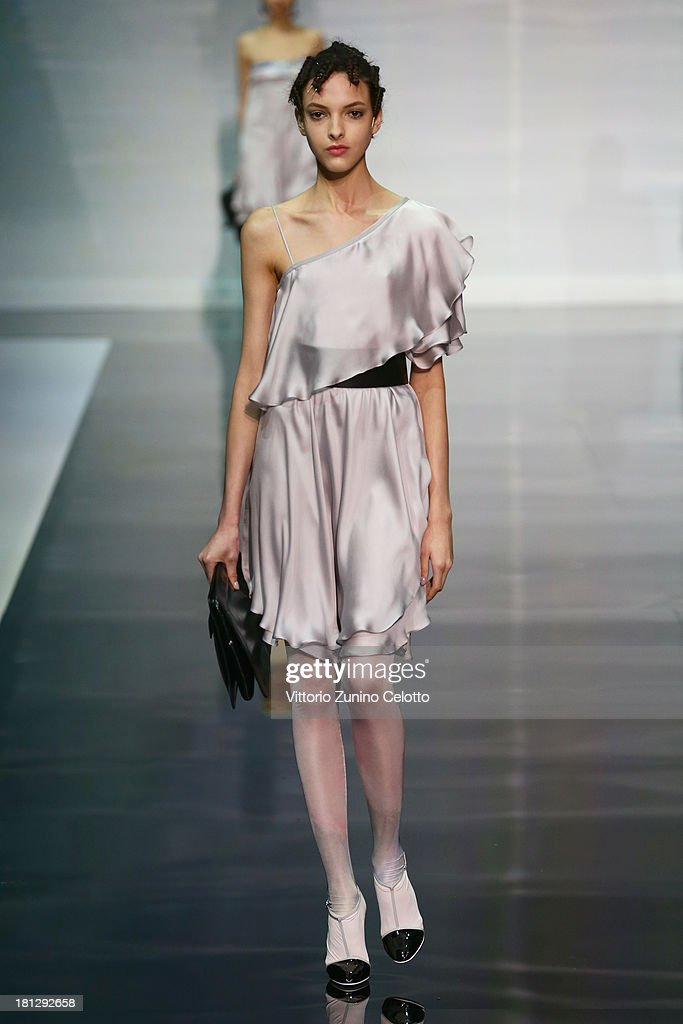 A model walks the runway during the Emporio Armani show as a part of Milan Fashion Week Womenswear Spring/Summer 2014 on September 20, 2013 in Milan, Italy.