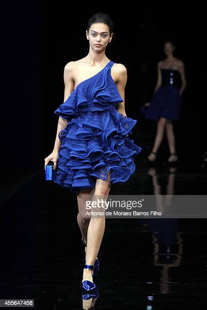 A model walks the runway during the Emporio Armani show as a part of Fashion Week Womenswear Spring/Summer 2015 on September 18 2014 in Milan Italy