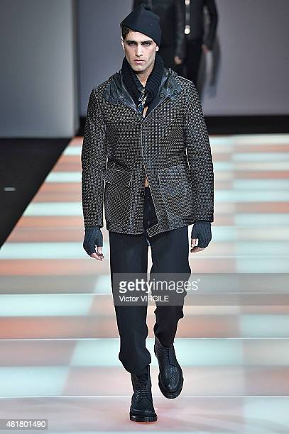 A model walks the runway during the Emporio Armani show as a part of Milan Menswear Fashion Week Fall Winter 2015/2016 on January 19 2015 in Milan...
