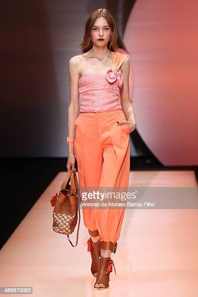 A model walks the runway during the Emporio Armani show as a part of Milan Fashion Week Spring/Summer 2016 on September 25 2015 in Milan Italy