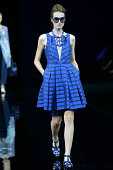 A model walks the runway during the Emporio Armani show as part of Milan Fashion Week Womenswear Spring/Summer 2015 on September 18 2014 in Milan...
