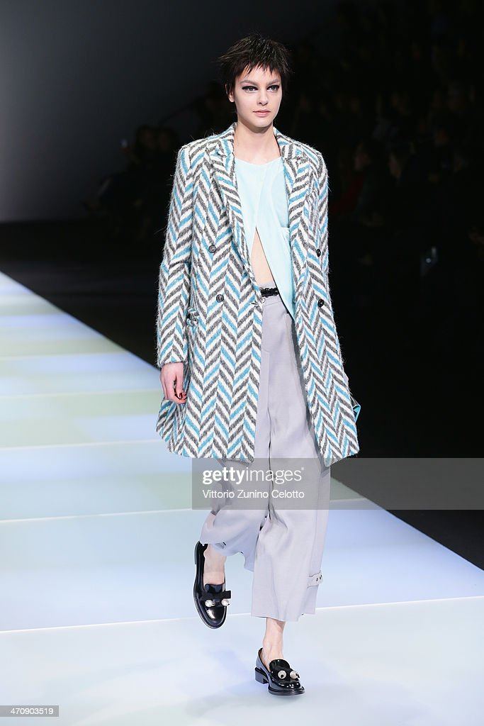 A model walks the runway during the Emporio Armani show as part of Milan Fashion Week Womenswear Autumn/Winter 2014 on February 21 2014 in Milan Italy