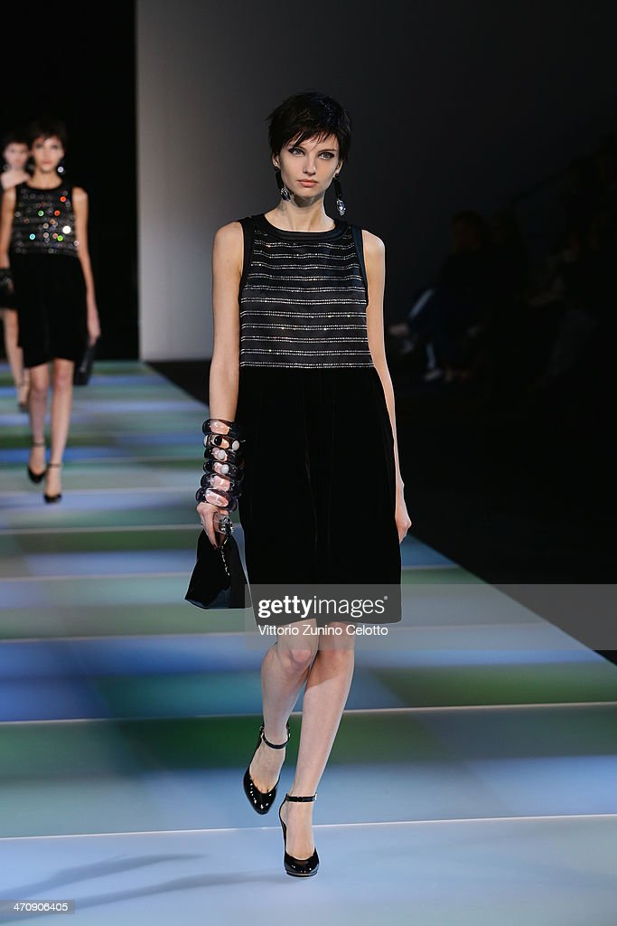 A model walks the runway during the Emporio Armani show as part of Milan Fashion Week Womenswear Autumn/Winter 2014 on February 21, 2014 in Milan, Italy.