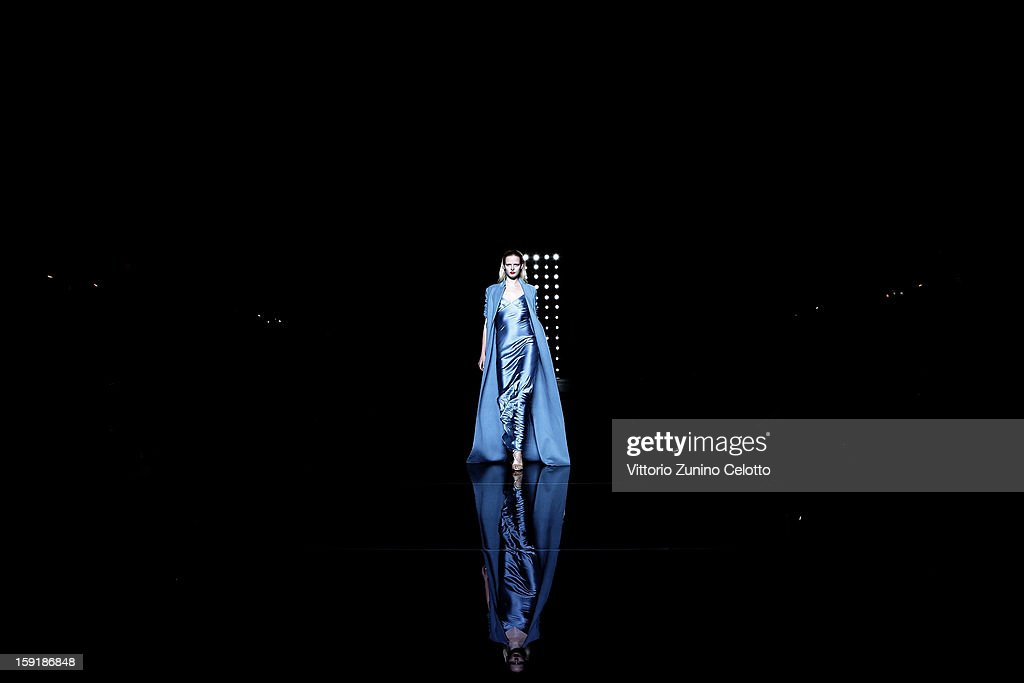 A model walks the runway during the Ermanno Scervino fashion show as part of Pitti Immagine Uomo 83 at Palazzo Vecchio on January 9, 2013 in Florence, Italy.