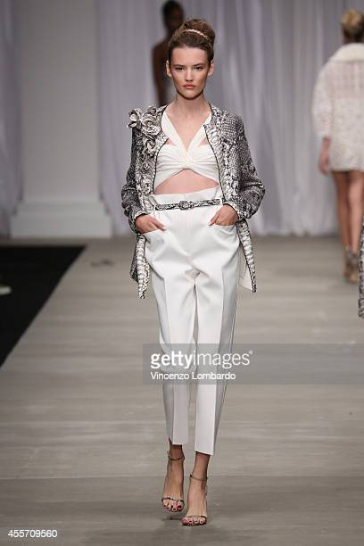 A model walks the runway during the Ermanno Scervino show as a part of Milan Fashion Week Womenswear Spring/Summer 2015 on September 19 2014 in Milan...