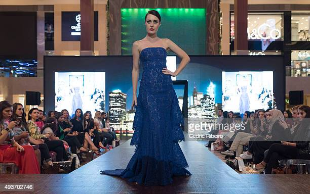 A model walks the runway during the Esposa show at Yas Mall on October 18 2015 in Abu Dhabi United Arab Emirates
