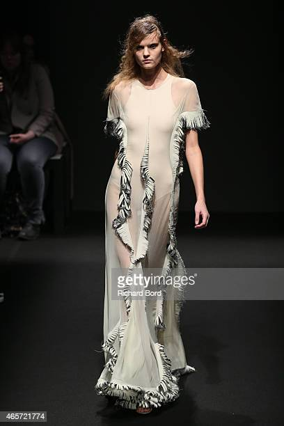 A model walks the runway during the Esteban Cortazar show as part of the Paris Fashion Week Womenswear Fall/Winter 2015/2016 on March 9 2015 in Paris...
