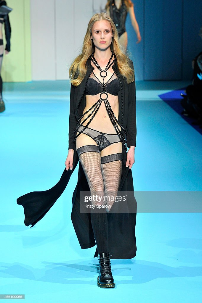 A model walks the runway during the ETAM show as part of Paris Fashion Week Womenswear Fall/Winter 2015/2016 at Piscine Molitor on March 3 2015 in...