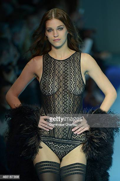 A model walks the runway during the ETAM show as part of the Paris Fashion Week Womenswear Fall/Winter 2015/2016 on March 3 2015 in Paris France