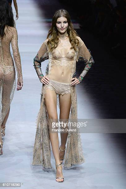 A model walks the runway during the Etam show as part of the Paris Fashion Week Womenswear Spring/Summer 2017 on September 27 2016 in Paris France