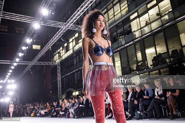 A model walks the runway during the Ethical Fashion on Stage during the MercedesBenz Fashion Week Berlin A/W 2017 on January 18 2017 in Berlin Germany