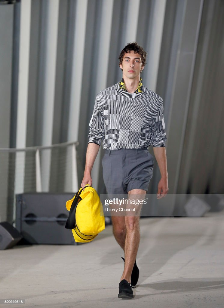 model-walks-the-runway-during-the-etudes-menswear-springsummer-2018-picture-id800519348