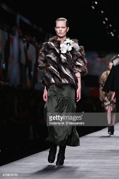 A model walks the runway during the Fendi show as part of Milan Fashion Week Womenswear Autumn/Winter 2014 on February 20 2014 in Milan Italy