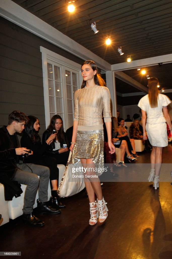 A model walks the runway during the Ferragamo presentation Spring Summer Runway Collection with VIP dinner, hosted by Jacqui Getty and Harpers BAZAAR at Chateau Marmont on January 24, 2013 in Los Angeles, California.