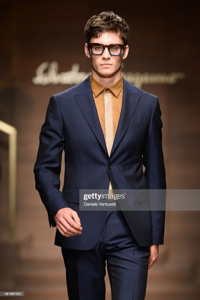 A model walks the runway during the Ferragamo show as a part of Milan Fashion Week Menswear Autumn/Winter 2014 on January 12, 2014 in Milan, Italy.