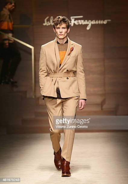 A model walks the runway during the Ferragamo show as a part of Milan Fashion Week Menswear Autumn/Winter 2014 on January 12 2014 in Milan Italy