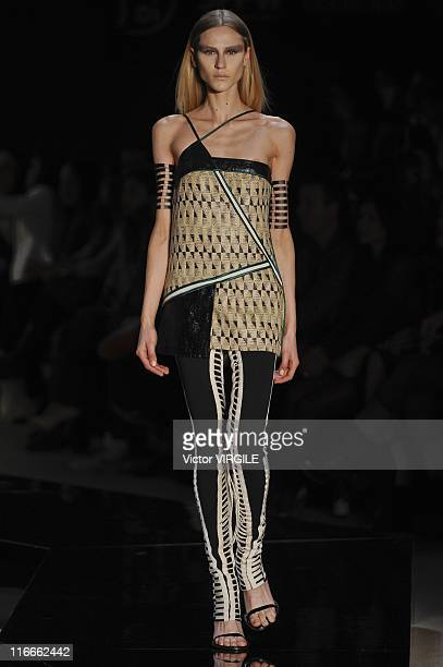 A model walks the runway during the Forum by Tufi Duek show of the Ready to Wear Spring/Summer 2012 collection as part of the Sao Paulo Fashion Week...