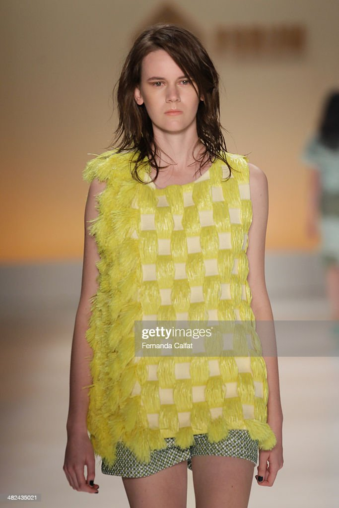 A model walks the runway during the Forum show at Sao Paulo Fashion Week Summer 2014/2015 at Parque Candido Portinari on April 3, 2014 in Sao Paulo, Brazil.