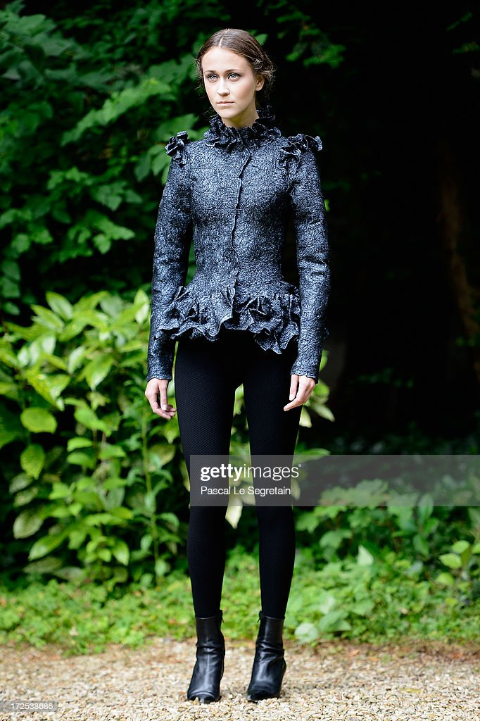 A model walks the runway during the Frank Sorbier show as part of Paris Fashion Week Haute-Couture Fall/Winter 2013-2014 at Hotel De Bezenval on July 3, 2013 in Paris, France.