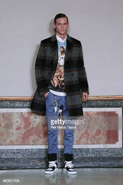 A model walks the runway during the Frankie Morello show as a part of Milan Fashion Week Menswear Autumn/Winter 2014 on January 14 2014 in Milan Italy