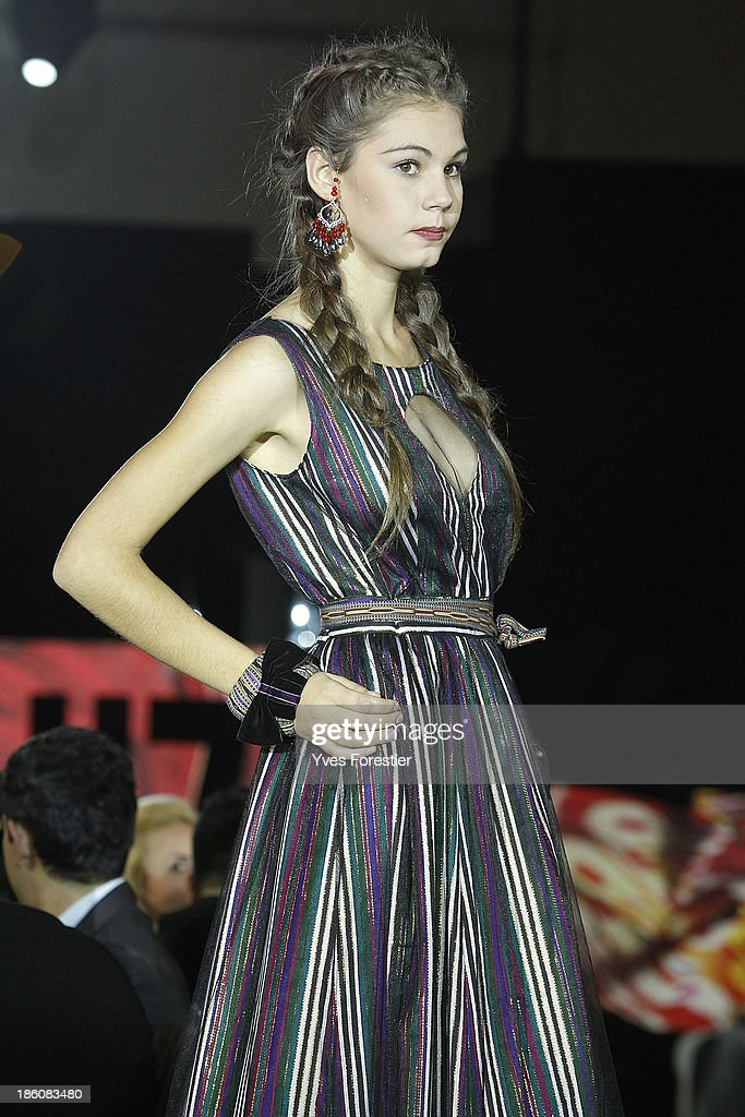 A model walks the runway during the General defile by Dom Stilya as part of the Art Style UZ 2013 at The Youth Art Palace on October 27, 2013 in Tashkent, Uzbekistan.