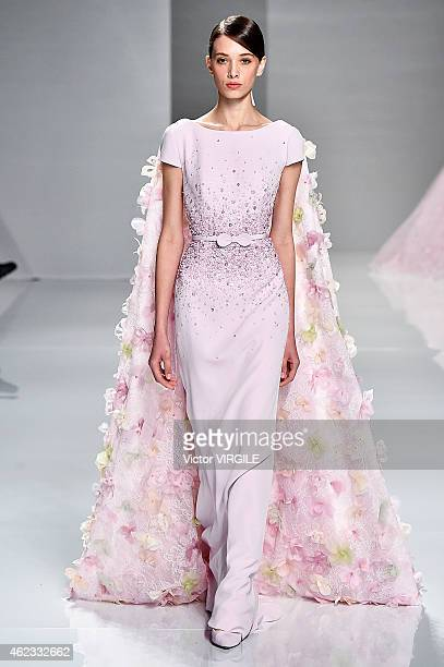 A model walks the runway during the Georges Hobeika show as part of Paris Fashion Week Haute Couture Spring/Summer 2015 on January 26 2015 in Paris...