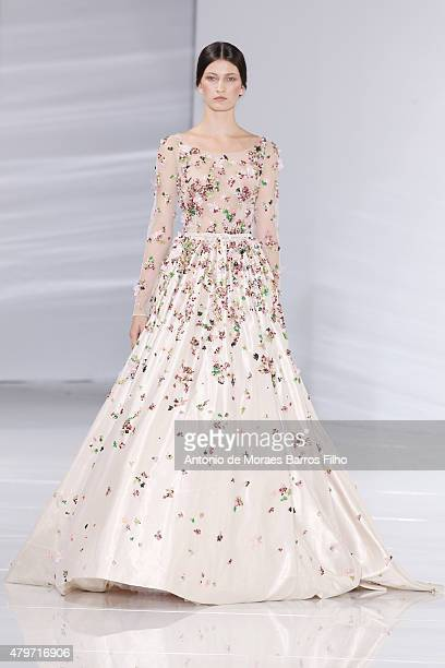 A model walks the runway during the Georges Hobeika show as part of Paris Fashion Week Haute Couture Fall/Winter 2015/2016 on July 6 2015 in Paris...