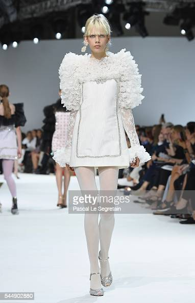 A model walks the runway during the Giambattista Valli Haute Couture Fall/Winter 20162017 show as part of Paris Fashion Week on July 4 2016 in Paris...