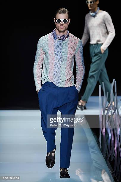 A model walks the runway during the Giorgio Armani fashion show as part of Milan Men's Fashion Week Spring/Summer 2016 on June 23 2015 in Milan Italy