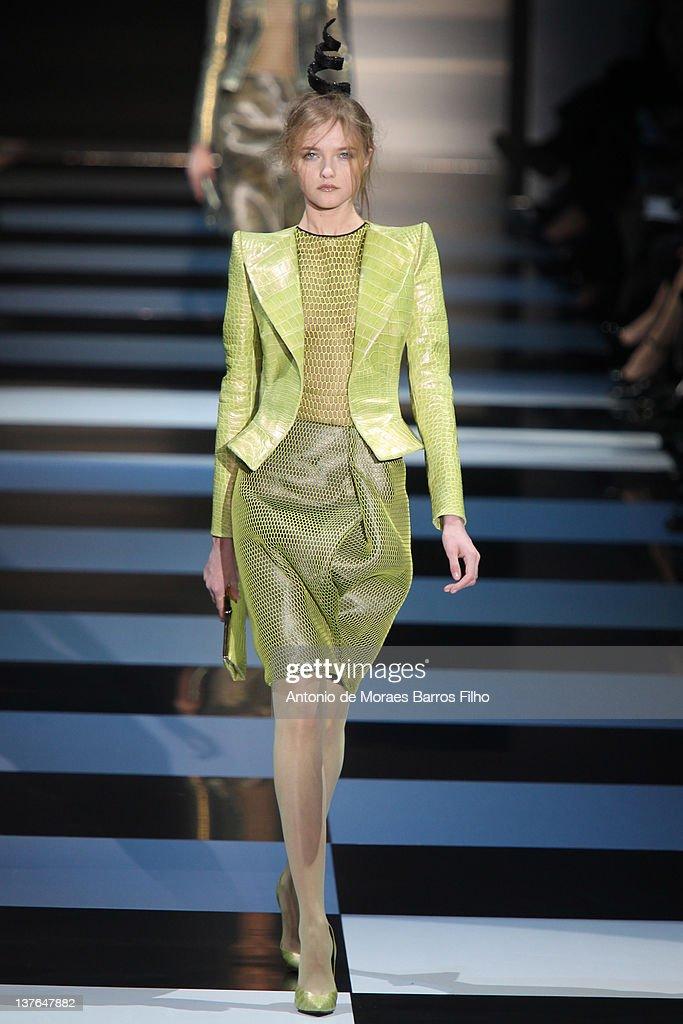 A model walks the runway during the Giorgio Armani Prive HauteCouture 2012 show as part of Paris Fashion Week as part of Paris Fashion Week at Grand...